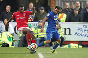 Charlton Athletic Anfernee Dijksteel (34)  fouling AFC Wimbledon striker Andy Barcham (17) for penalty during the The FA Cup match between AFC Wimbledon and Charlton Athletic at the Cherry Red Records Stadium, Kingston, England on 3 December 2017. Photo by Matthew Redman.