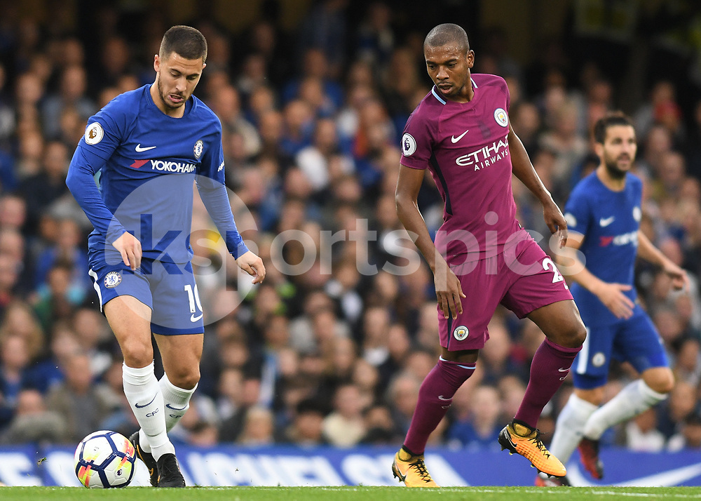 Eden Hazard of Chelsea and Fernandinho of Manchester City in action during the Premier League match between Chelsea and Manchester City at Stamford Bridge, London, England on 30 September 2017. Photo by Vince Mignott.