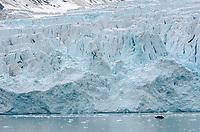 Zodiac in front of Monacobreen glacier in Liefdefjorden on Albert I Land in the Svalbard archipeligo, Norway.