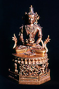 Amitaba Buddha in his manifestation of 'Boundless Life' sitting holding a vessel containing the nectar of immortality. Tibetan Art. Bronze. 18th century.