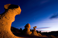 Hoodoos glow at dusk in Goblin Valley State Park, Utah.
