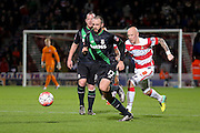 Stoke City defender Marc Wilson  chased down by Doncaster Rovers midfielder Richard Chaplow  during the The FA Cup third round match between Doncaster Rovers and Stoke City at the Keepmoat Stadium, Doncaster, England on 9 January 2016. Photo by Simon Davies.