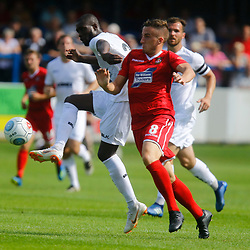 Dovers midfielder Bedsenté Gomis controls the ball as Wrexhams midfielder Luke Young tries to tackle him during the opening National League match between Dover Athletic and Wrexham FC at Crabble Stadium, Kent on 04 August 2018. Photo by Matt Bristow.