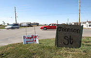A car waits to turn onto Highway 57 from Johnson Street in Parkersburg, Iowa on Friday October 3, 2008. Many roads are still using plywood signs as street signs. (Stephen Mally / Special to The Denver Post)