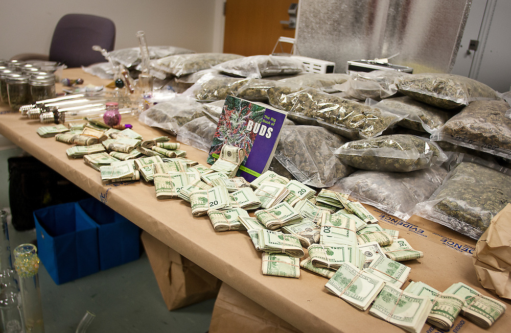 Drug paraphernalia, around 44 pounds of marijuana, and $67,000 in cash were collected from a recent drug bust in Magna at the residence of Matthew White, shown on display here at the Unified Police Department Evidence and Operations Building, Friday, Jan. 4, 2013.