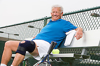 Man wearing knee band on tennis court