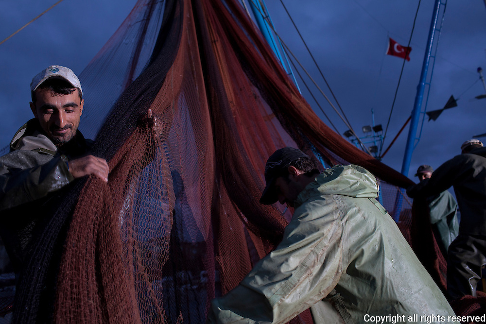Fishermen work their nets in the Black Sea city of Sinop, Turkey