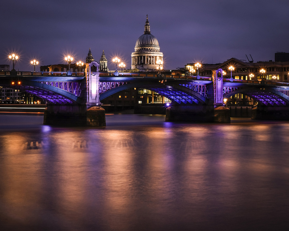 St Paul's Cathedral and Southwark Bridge, with the reflections of the river Thames in London at night.