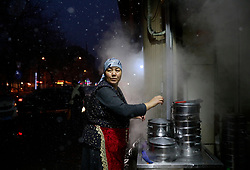 An ethnic Uighur woman tends to her food stall as snow falls in Urumqi city, Xinjiang Uighur Autonomous Province, China, 16 November 2017. Uighurs, a Muslim ethnic minority group in China, make up about 40 per cent of the 21.8 million people in Xinjiang, a vast, ethnically divided region that borders Pakistan, Afghanistan, Kazakhstan, Kyrgyzstan and Mongolia. Other ethnic minorities living in here include the Han Chinese, Kyrgyz, Mongolian and Tajiks people. Xinjiang has long been subjected to separatists unrests and violent terrorist attacks blamed by authorities on Islamist extremism while human rights groups say Chinese repression on religious rights, culture and freedom of movement caused undue tensions. Life however goes on under the watchful eye of the government for the ethnic Uighurs living in the city of Urumqi and surrounding areas and the region is still considered an attractive tourist spot. A recent report by state media Xinhua news agency claims Xinjiang received more than 100 million tourists in 2017, 'the highest figure in its history'.