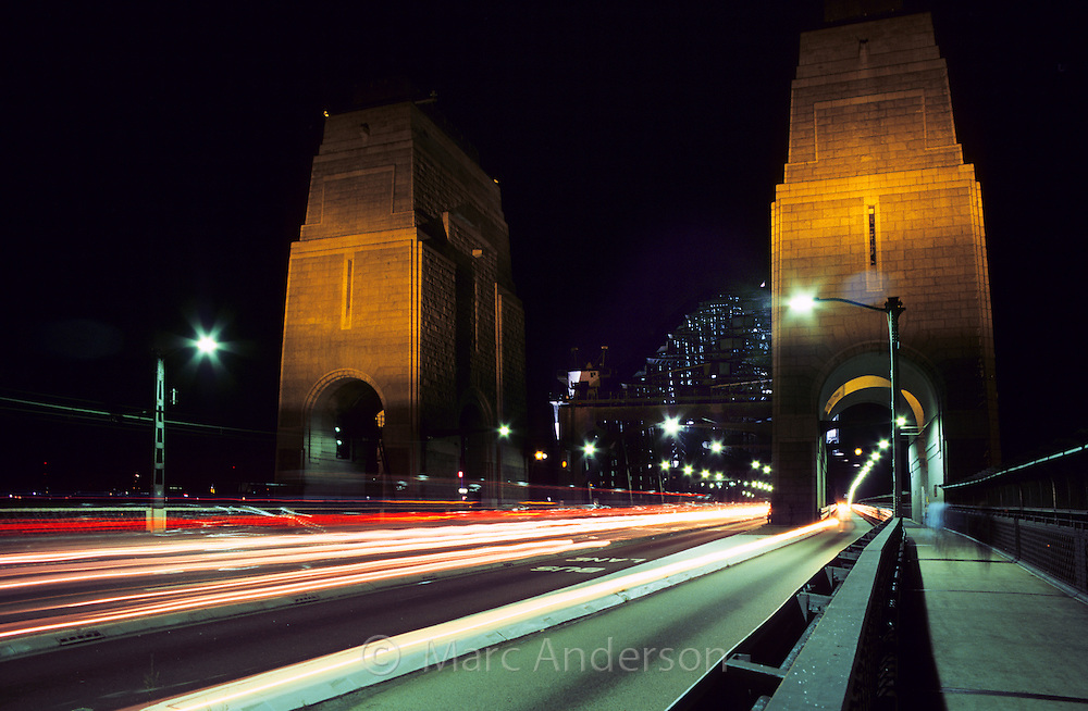 Pillars and car trails of traffic on the Sydney Harbour Bridge, Sydney, Australia.