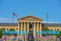 Campaign signs reading Stronger Together are seen ahead of a rally with President Barack Obama as he stumps in support of Democratic Presidential candidate Hillary Clinton at a September 13, 2016 rally at the foot of the Art Museum Steps in Philadelphia, Pennsylvania.