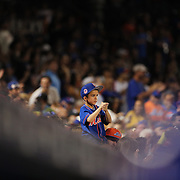 NEW YORK, NEW YORK - July 02: A young New York Mets fan watching during the Chicago Cubs Vs New York Mets regular season MLB game at Citi Field on July 02, 2016 in New York City. (Photo by Tim Clayton/Corbis via Getty Images)