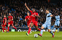 Manchester City's Sergio Aguero and Wes Morgan of Leicester City  - Photo mandatory by-line: Matt McNulty/JMP - Mobile: 07966 386802 - 04/03/2015 - SPORT - football - Manchester - Etihad Stadium - Manchester City v Leicester City - Barclays Premier League