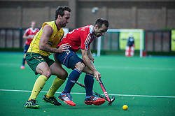 England's Nick Catlin is pressured by Liam De Young of Australia. England v Australia, Bisham Abbey, Marlow, UK on 25 May 2014. Photo: Simon Parker