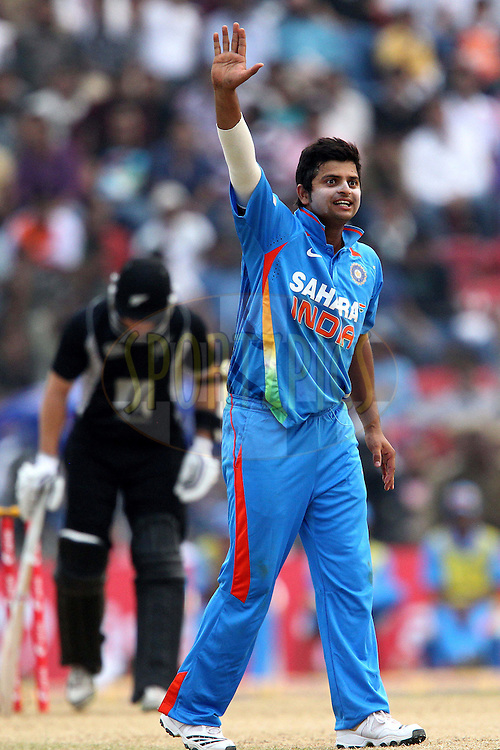 Suresh Raina of India appeals for the wicket of Kyle Mills  during the 1st ODI (One Day International ) between India and New Zealand held at the Nehru Cricket Stadium in Guwahati, Assam, India on the 28th  November 2010..Photo by Ron Gaunt/BCCI/SPORTZPICS
