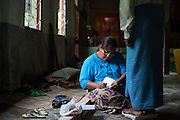 A clinic assistant records a patient's weight at Oakahta Yama Monastery in South Dagon township, Yangon, on June 29, 2014.