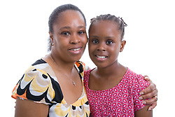 Portrait of a mother and daughter in the studio,
