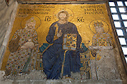 "Istanbul. Hagia Sophia (a former church turned into a mosque, and now a museum). Christian mosaic ""Christ Pantokrator"". Jesus Christ enthroned between Empress Zoe and Constantine IX Monomakhos."