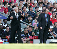 Photo. Andrew Unwin, Digitalsport<br /> NORWAY ONLY<br /> <br /> Liverpool v Newcastle United, FA Barclaycard Premier League, Anfield, Liverpool 15/05/2004.<br /> Newcastle's Sir Bobby Robson (l) and Liverpool's Gerrard Houllier (r) encourage their teams.