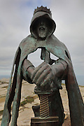 Statue entitled Gallos (Cornish for 'power') thought to represent King Arthur with Excalibur, 2016, by Rubin Eynon, at Tintagel Castle, built by Richard, 1st Earl of Cornwall in the 13th century, Tintagel Island, Cornwall, England. The ruined castle is linked with Arthurian Legend, as Geoffrey of Monmouth cited it as the place of conception of King Arthur in his 12th century book, History of the Kings of England. The site is managed by English Heritage. Picture by Manuel Cohen. Further clearances may be requested.
