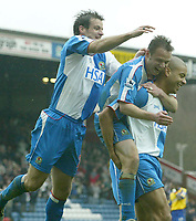 Photo Aidan Ellis, Digitalsport<br /> Blackburn Rovers v Southampton.<br /> Ewood Park.<br /> FA Barclays Premiership.<br /> 09/04/2005.<br /> Blackburn's Ryan Nelsen and Paul Dickov jump on third goal scorer Steven Reid after the third goal