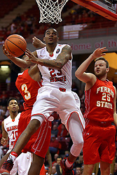 26 November 2016:  Deontae Hawkins(23) fakes out Markese Mayfield and Andrew Meacham with a reverse scoop shot during an NCAA  mens basketball game between the Ferris State Bulldogs the Illinois State Redbirds in a non-conference game at Redbird Arena, Normal IL