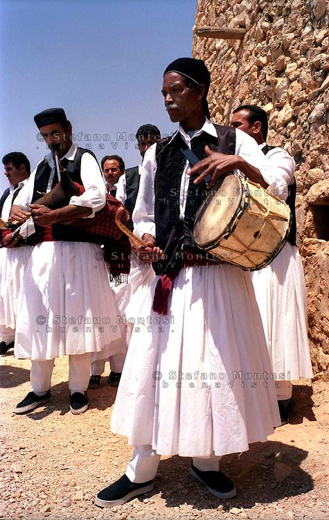 Libya     Nalut ..Berber granary with Ghorfas at Ksarr Qasr-al-Hadj Nafusah Mountains Libya .Folk  musical group