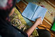 Tabasum Khatun, 14, is studying the Holy Koran in the Madrassa of Algunda village, pop. 1000, Giridih District, rural Jharkhand, India.