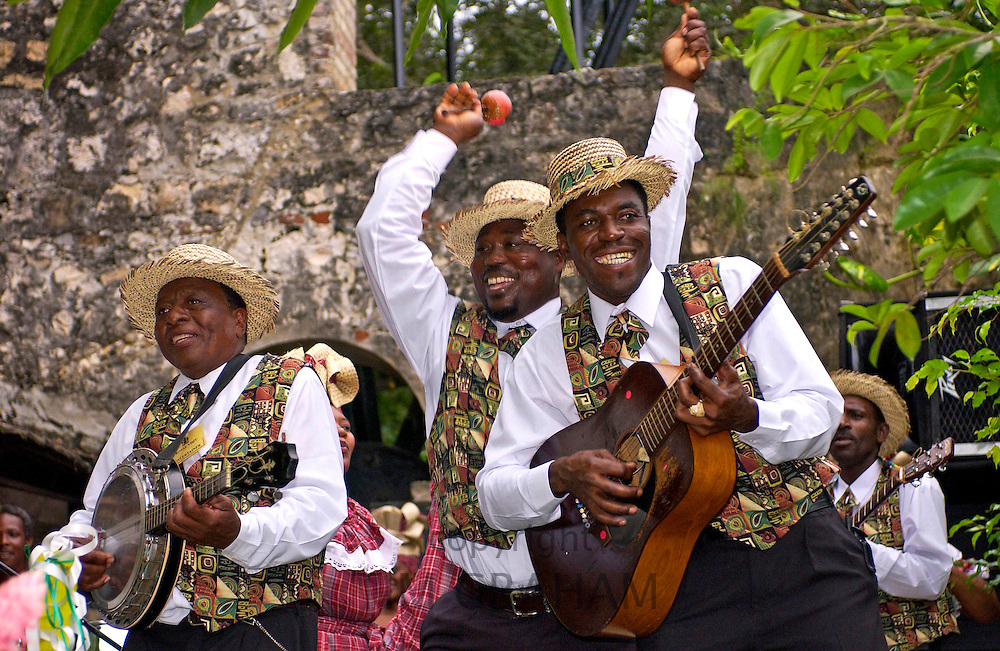Musicians, playing guitar, banjo and maracas, at the Governor General's Garden Fair at the Half Moon Hotel in Jamaica