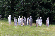 "Wooden ""People"" in a field near Ganges on Salt Spring Island, British Columbia, Canada."