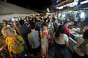 Visitors and locals walk through the weekly night market in Garapan, Saipan.  .Robert Gilhooly Photo