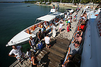 Passengers disembark from a boat upon their arrival to Isla Grande, one of the islands in an archipelago known as Islas del Rosario, about 35km southwest of Cartagena, on Colombia's Caribbean coast on January 2, 2009. (Photo/Scott Dalton)