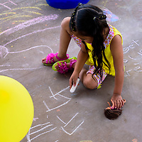 Serenity Maes plays with chalk at the 7 Trails of Gold Outdoor Festival in Grants, New Mexico on Saturday, June 3, 2017. The event offered an array of activities for children, including chalk art, face painting, and bubbles.