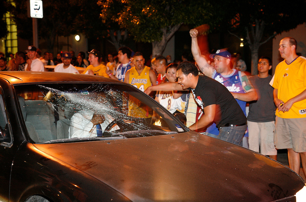 The window of a vehicle gets smashed as fans of the Los Angeles Lakers get out of hand following the team's victory in the 2010 NBA Finals Championship against the Boston Celtics outside the Staples Center in Los Angeles California, USA, 17 June 2010.