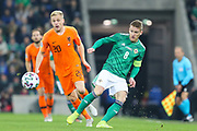 Northern Ireland midfielder Steven Davis (8) plays the ball as Netherlands midfielder Donny van de Beek (20) watches on during the UEFA European 2020 Qualifier match between Northern Ireland and Netherlands at National Football Stadium, Windsor Park, Northern Ireland on 16 November 2019.