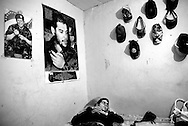 Maximo, 34, rests in his room adorned with side-by-side posters of Che Guevara and Hugo Chavez on Tuesday, Jan. 8, 2008. Maximo is the only adult male responsible for providing for the sixteen women and children that live in his family home located in the red zone of Belen.  He proudly identifies himself as a member of the Bolivarian Revolution, sympathetic to the though of legendary Latin American revolutionary, Che Guevara and present day President of the Bolivarian Republic of Venezuela, Hugo Chavez. Maximo was fatally shot on Thursday, April 24, 2008 in Belen.