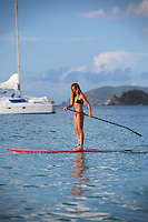 Beautiful athletic paddleboarder on the water of Cinnamon bay beach St. John, USVI.