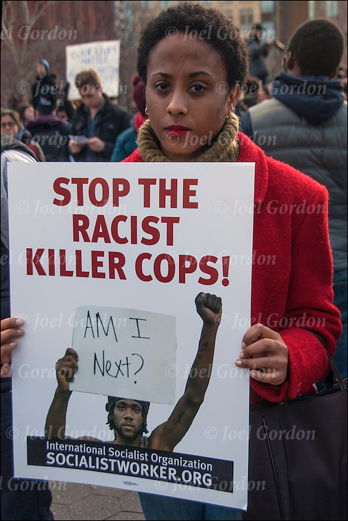 African American female holding sign &quot;Stop Racist Killer Cops!   Am I Next ?&quot; in Washington Square Park.<br /> <br /> Grassroots, nonviolent efforts of  street protests, following the deaths of Eric Garner, Michael Brown and Akai Gurley have helped America talk more openly about race and to see meaningful changes in law enforcement practices and accountability mechanisms.<br /> <br /> The protesters, who were black, white, Latino, Asian, young and elderly, streamed through  New York. They carried protest signs that read &ldquo;Hands Up, Don&rsquo;t Shoot&rdquo; and banners that read &ldquo;Black Lives Matter&rdquo;.
