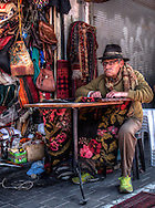 Man repairing carpet at the Jaffa flea-market