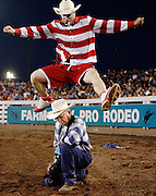 Entertainer Crash Cooper shows off his photographer hurdling skills on Saturday, Aug. 11, leaping over Bob Click of Washougal, Wash. during the last day of the 2012 Farm City Pro Rodeo in Hermiston.