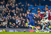 Chelsea midfielder Mason Mount (19) charges past Aston Villa defender Tyrone Mings (40) during the Premier League match between Chelsea and Aston Villa at Stamford Bridge, London, England on 4 December 2019.