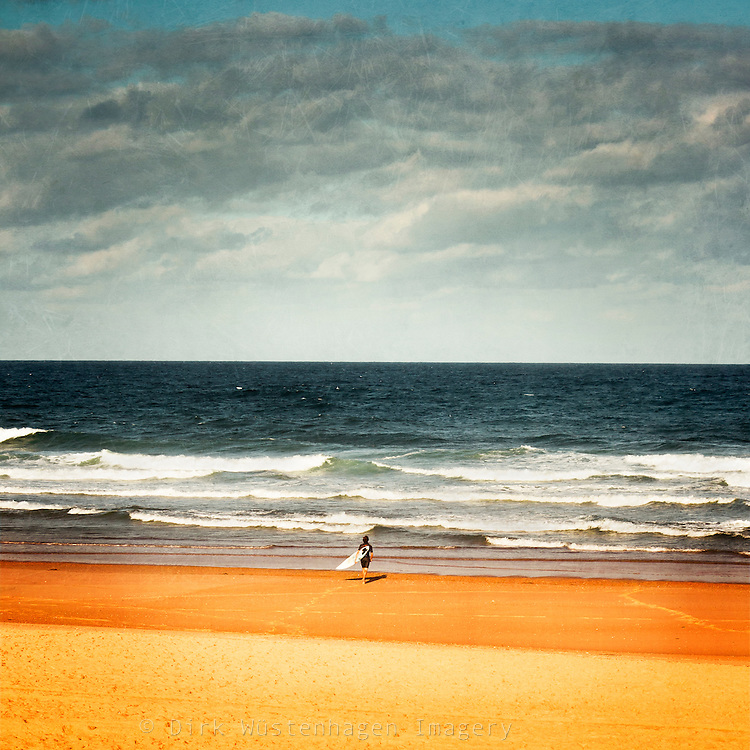 Surfer on his way to the sea.<br />