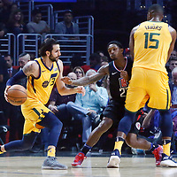 30 November 2017: Utah Jazz guard Ricky Rubio (3) drives past LA Clippers guard Lou Williams (23) on a screen set by Utah Jazz forward Derrick Favors (15) during the Utah Jazz 126-107 victory over the LA Clippers, at the Staples Center, Los Angeles, California, USA.