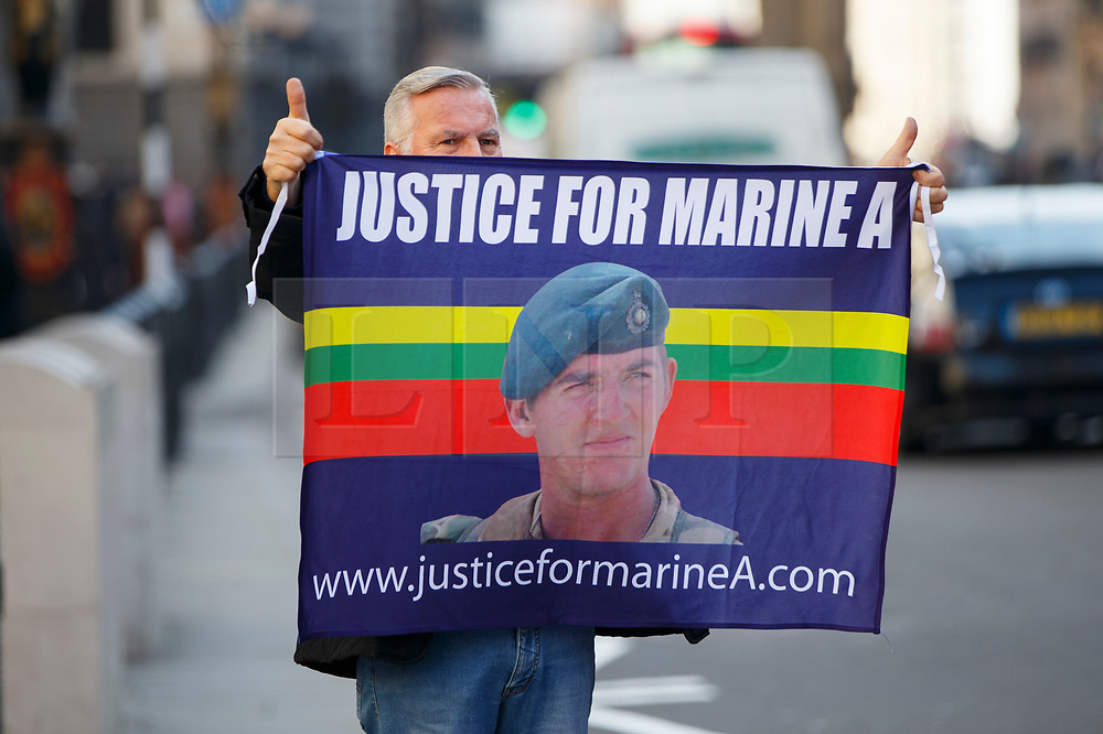 © Licensed to London News Pictures.15/03/2017.London, UK. Campaigners protest outside the Royal Courts of Justice in London, where a ruling was made in an appeal against the conviction of Sgt Blackman.  Also known as Marine A, Sgt Blackman's life sentence for the murder of a wounded Taliban fighter in Afghanistan in 2011 reduced to manslaughter.Photo credit: Tolga Akmen/LNP