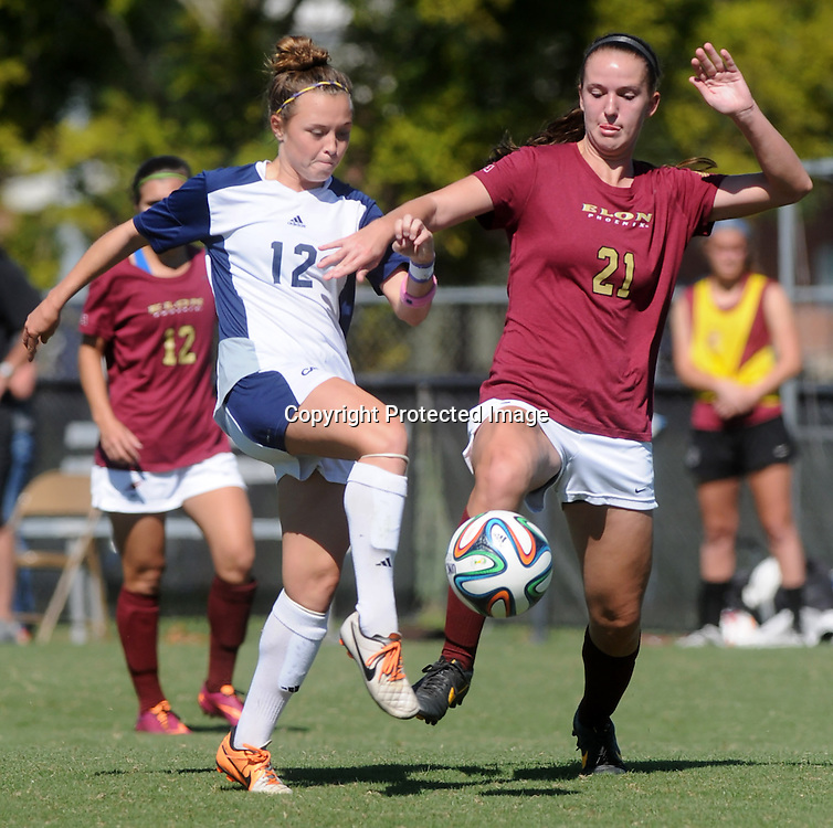 UNCW's Serenity Waters challenges Elon's Rachel Hallman Sunday October 5, 2014. (Jason A. Frizzelle)