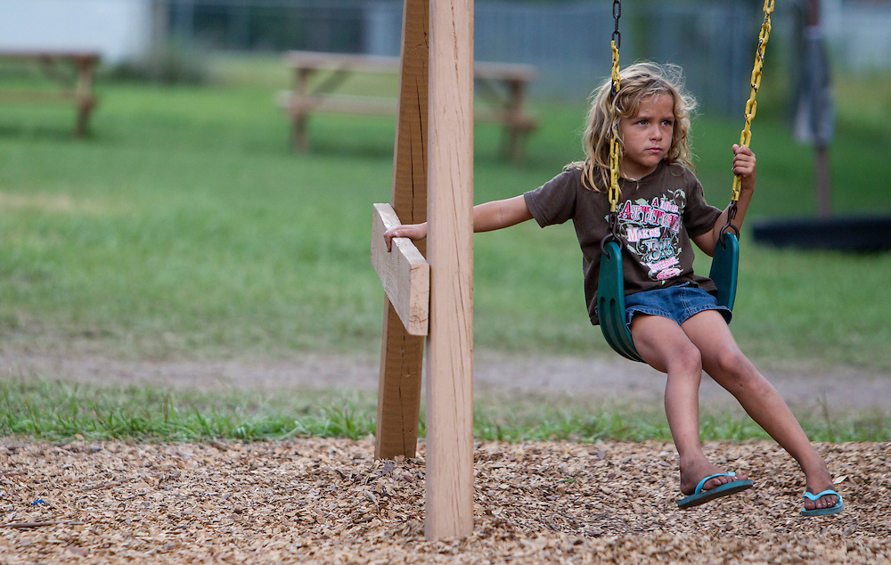 A young girl plays on the swings at one of the Thursday night cook outs at the Orange County Academy.<br /> WILLIE J. ALLEN JR.