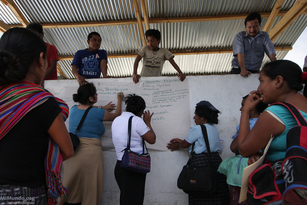Women affiliated to the Campesino Committee of the Highlands (CCDA, in Spanish) participate in an activity during the CCDA's annual meeting. The CCDA was founded in 1982 as an organization that works to defend the rights of workers on large coffee, sugar and cotton plantations, to recover lands taken from the Mayan communities over the past centuries, and to promote and recover Mayan culture and spirituality. Today about 100 communities in 11 Guatemalan provinces are affiliated to the CCDA, but the organization is strongest in the Madre Vieja valley of Sololá. Quixaya, San Lucas Toliman, Solola, Guatemala. March 2, 2010.