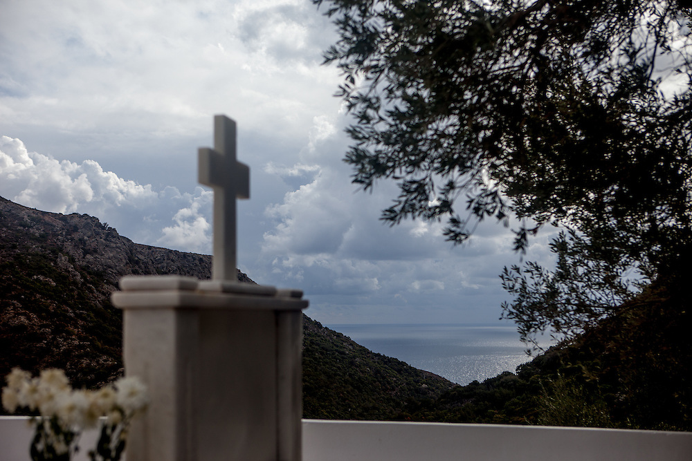 Cemetery of the small mountain village of Anidri with a view to the Lybian Sea Coast in Palaiochora which is a small town in Chania regional unit on the island of Crete, Greece. It is located 77 km south of Chania, on the southwest coast of Crete and occupies a small peninsula 400m wide and 700m long. The town is set along 11 km of coastline bordering the Libyan Sea. Its population was 1,675 in the 2011 census. Palaiochora's economy is based on tourism and agriculture (mainly tomatoes cultivated in glass houses and also olive oil).