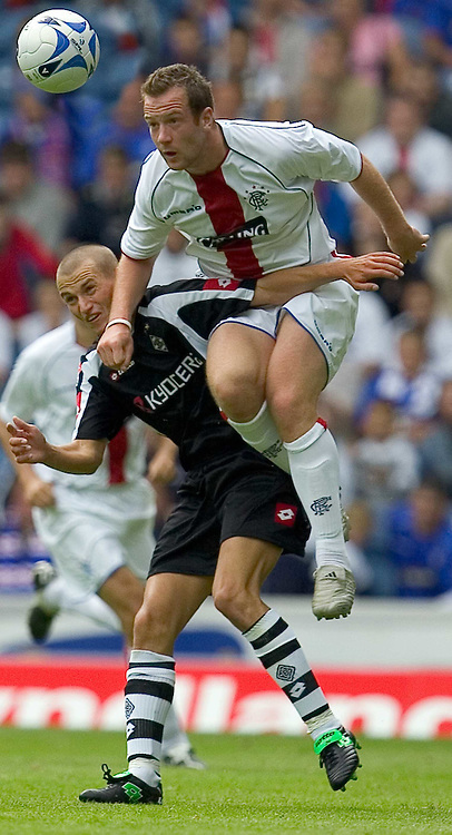 Rangers v Borussia Munchengladbach pre season friendly at Ibrox Park...Pic Noah Boardman/SBI/WROFOTO..Saturday 23/07/2005..Kluge loses out as Charlie Adam breaks through