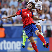 Carli Lloyd, U.S. Women's National Team and So-Yun Ji, Korean Republic, challenge for the ball during the U.S. Women's National Team Vs Korean Republic, International Soccer Friendly in preparation for the FIFA Women's World Cup Canada 2015. Red Bull Arena, Harrison, New Jersey. USA. 30th May 2015. Photo Tim Clayton